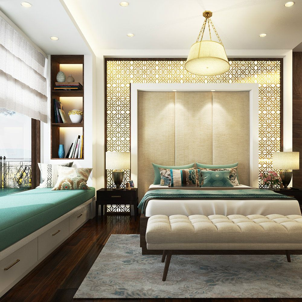 A beautifully lot bedroom complete with jali designs and a sitting