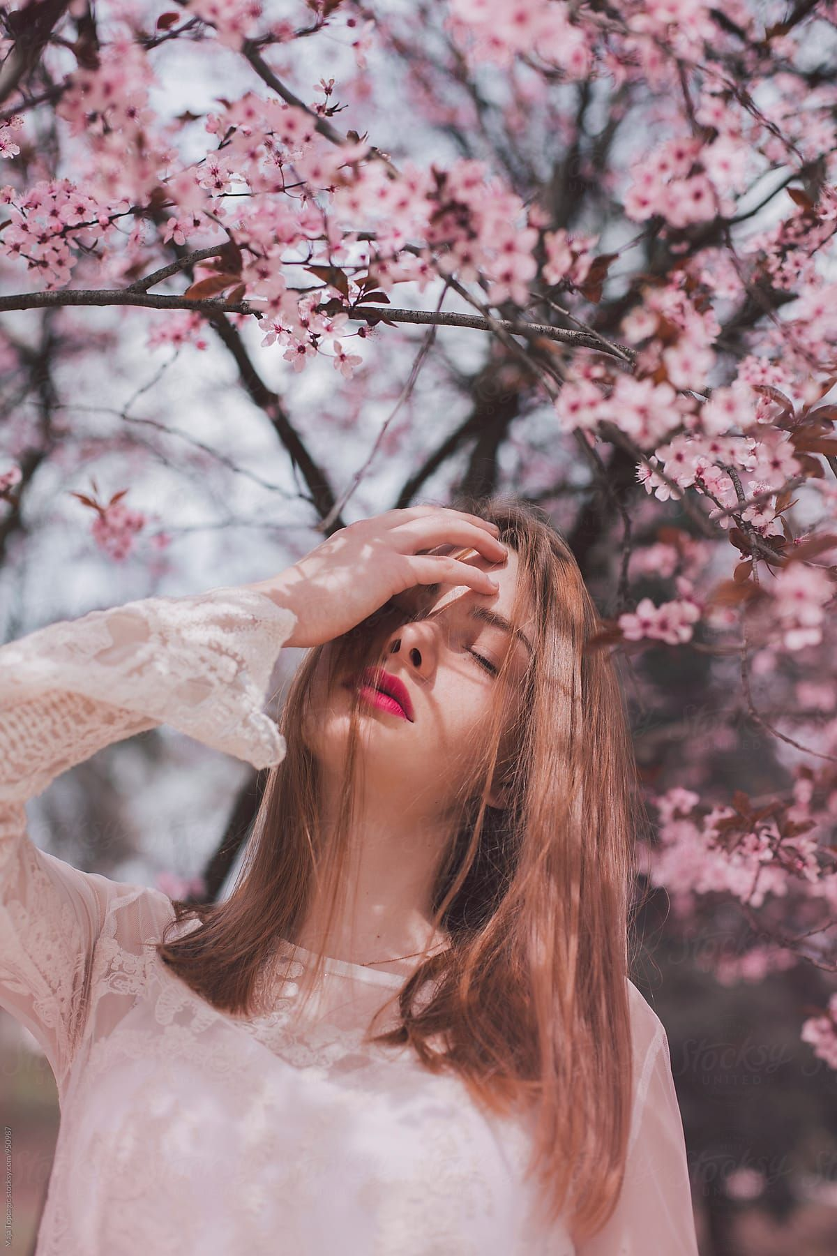 Portrait Of A Freckled Woman In Pink Blossom Tree Stocksy United Portrait Photography Poses Spring Photoshoot Photography Poses Women