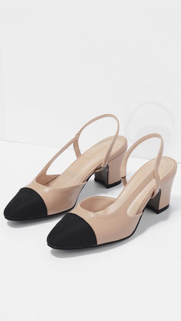 4fb59f3f5744 Two-tone slingback pumps with an elegant pointed toe and comfortable kitten  heel. Finished with a slingback strap