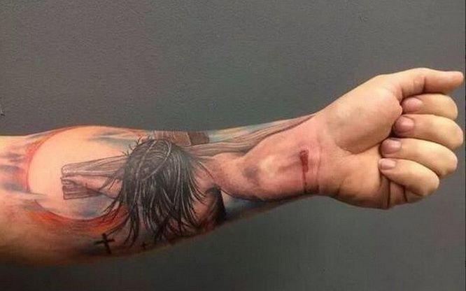 Optical illusion tattoo arm