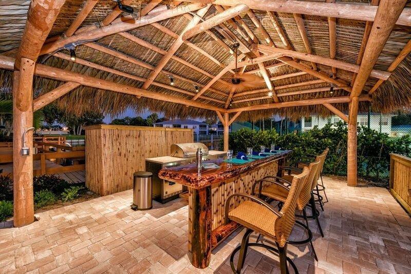 Custom Tiki Hut & Tiki Bar Outdoor Kitchen in Osprey ... on Backyard Tiki Hut Designs id=69643