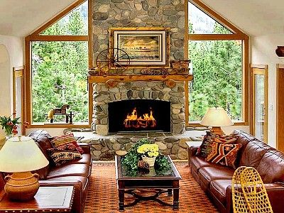 fireplace windows. Great placing for a fireplace  between 2 windows with the view of woods