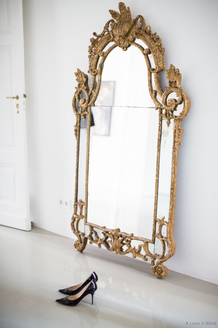 This spectacular golden wall mirror is the star of any living room ...