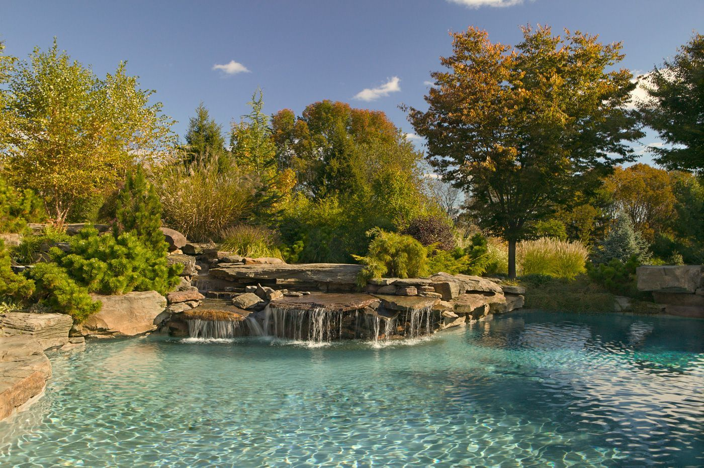 cool natural swimming pool designs ideas waterfall swimming pool idea with natural look decoration ideas - Natural Swimming Pool Designs