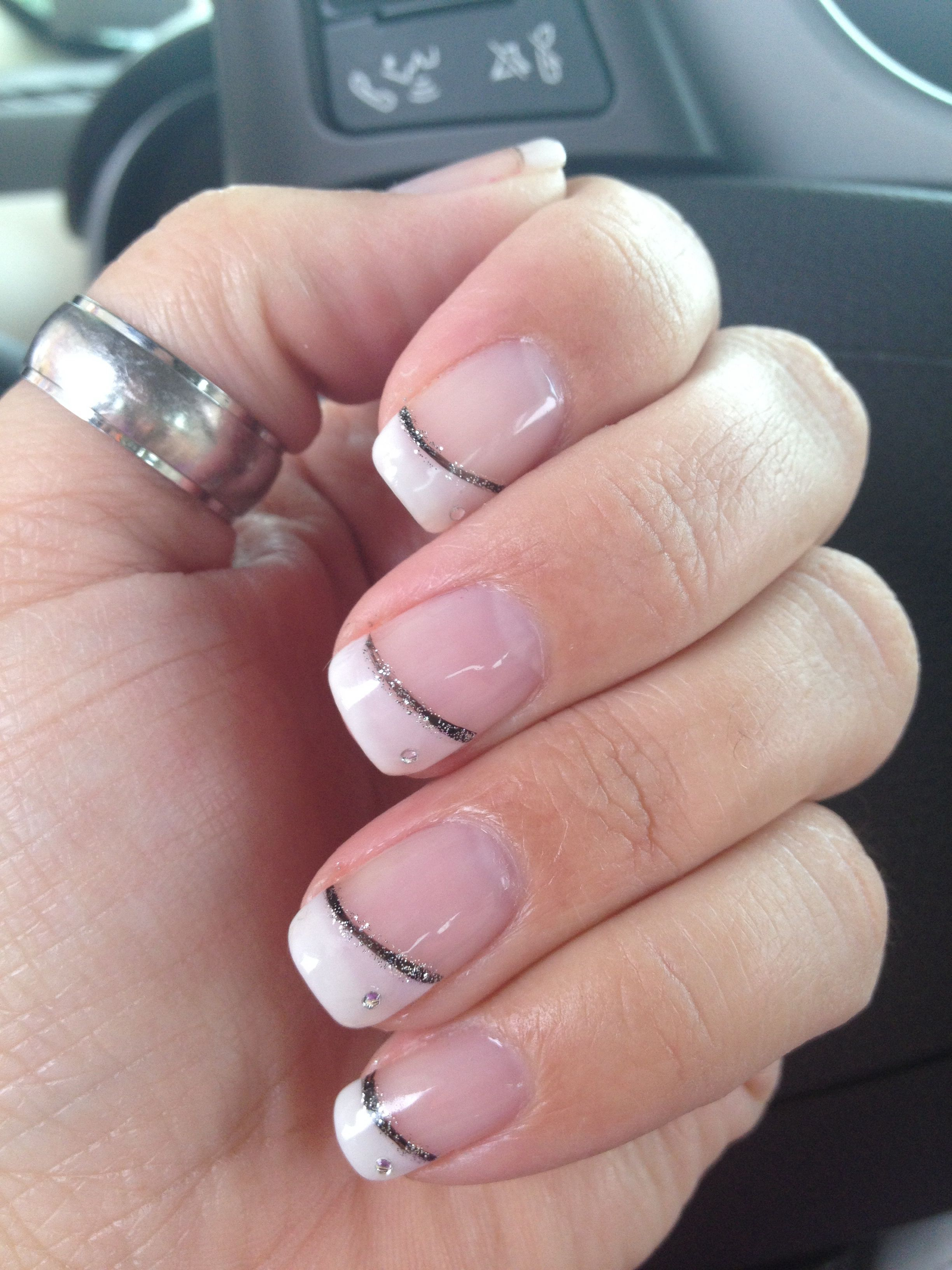 Angled French manicure with black and silver accent line and a ...