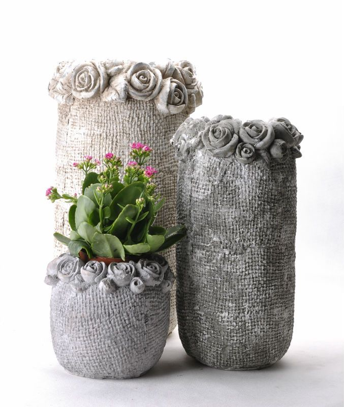Cement Flower Pots Note Does Not Give Tut But Probably Use Cement Laced Burlap Make The Vase Let Dry And Add Flower Cement Flower Pots Flower Pots Papercrete