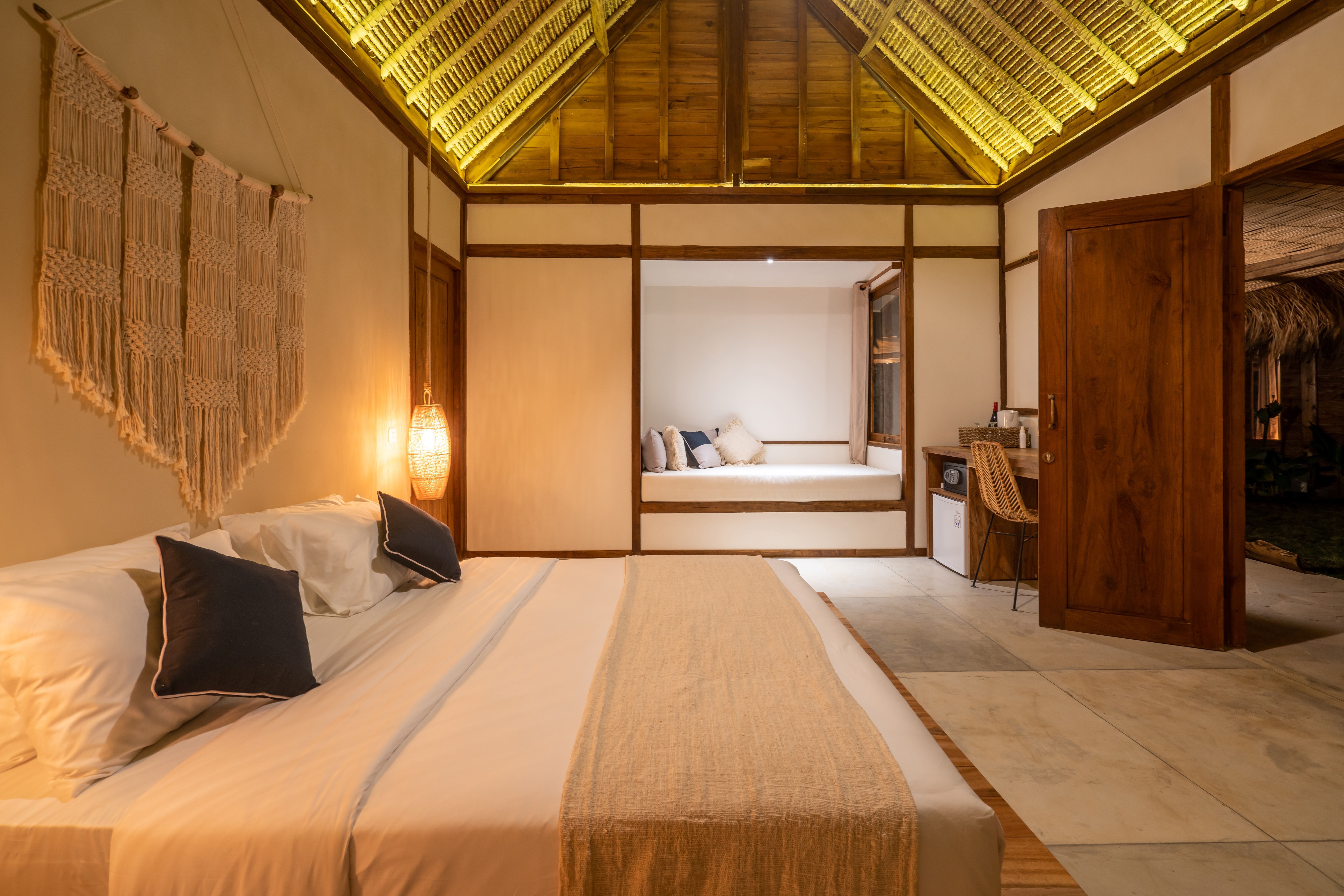 Angkasa Honeymoon Suite Offers A Cosy Boho Bedroom With A Daybed To Unwind Desk With Safe And Mini Fridge For Some Extra Ref Boho Bedroom Honeymoon Suite Home