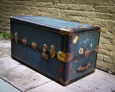 Vintage steamer trunk with shipping stickers still attached