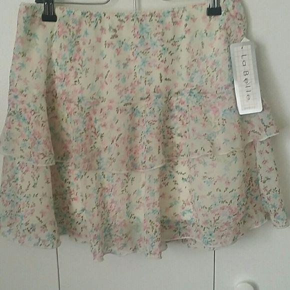 LaBelle flower skirt Cute white skirt with pretty flower pattern. Elastic waist. Made in the USA. Never worn. Built in slip. La Belle Skirts Mini