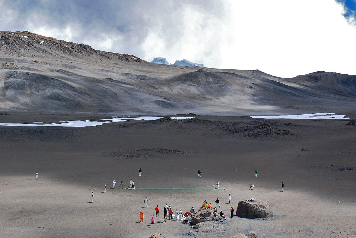 Cricketers play on the icecovered crater of kilimanjaro