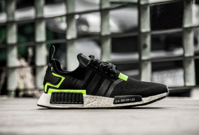 The Adidas NMD R1 Black / Volt are