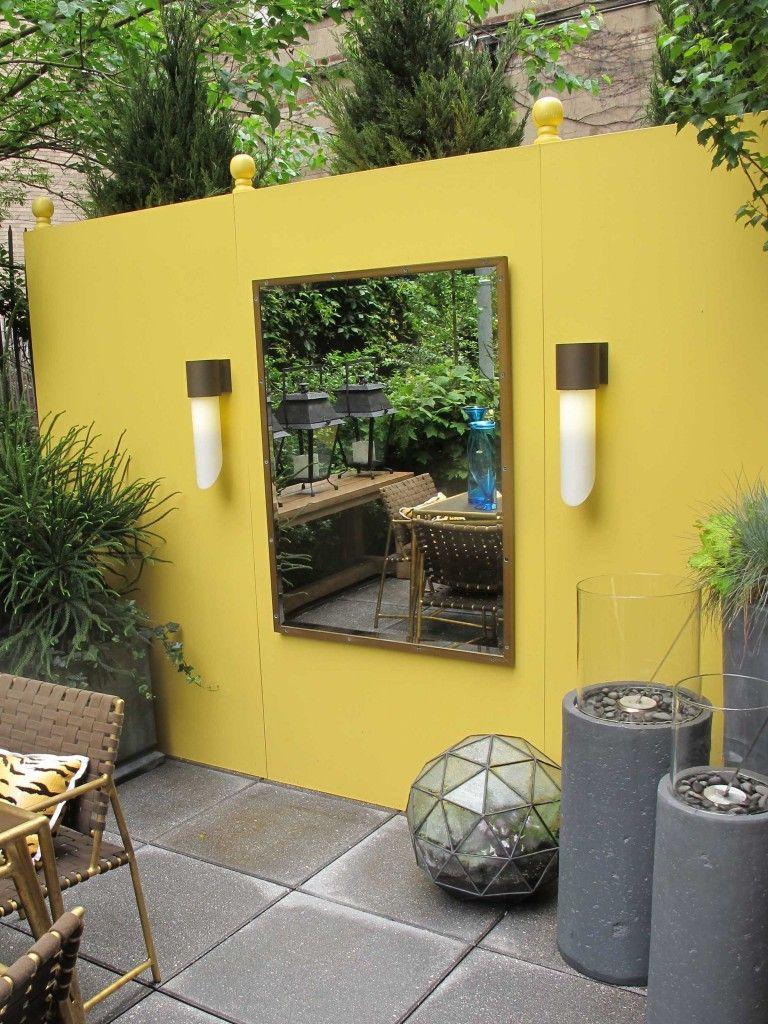 Yellow mirrored courtyard wall | Garden and yard ideas | Pinterest ...