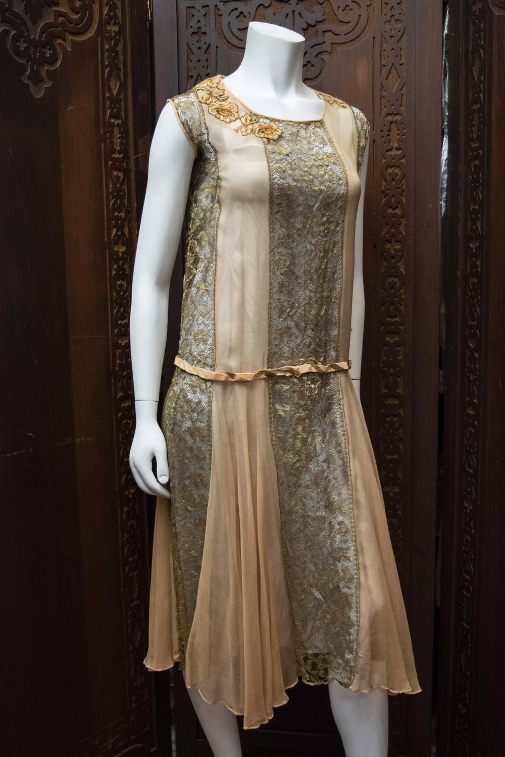 d11ae92821 1920s Lace and Silk Georgette Dress Early 1920s dress made from gold lamé  lace threads featuring a peach silk georgette inserts