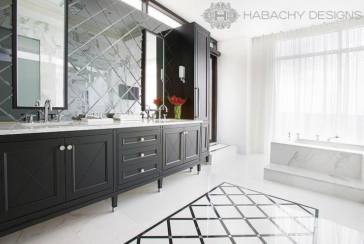 Stunning Master Bathroom Features A Black Dual Bathroom Vanity With Feet Which Is Topped With White Marble Under