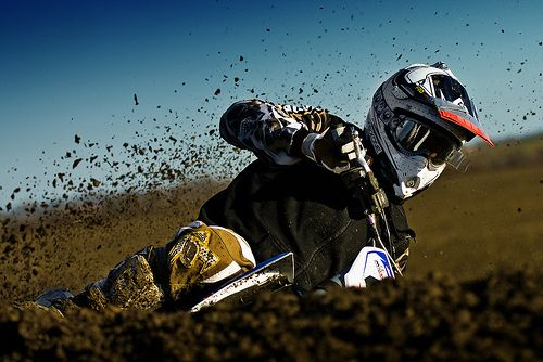 action_photography_of_motorcross_rider_and_dirt