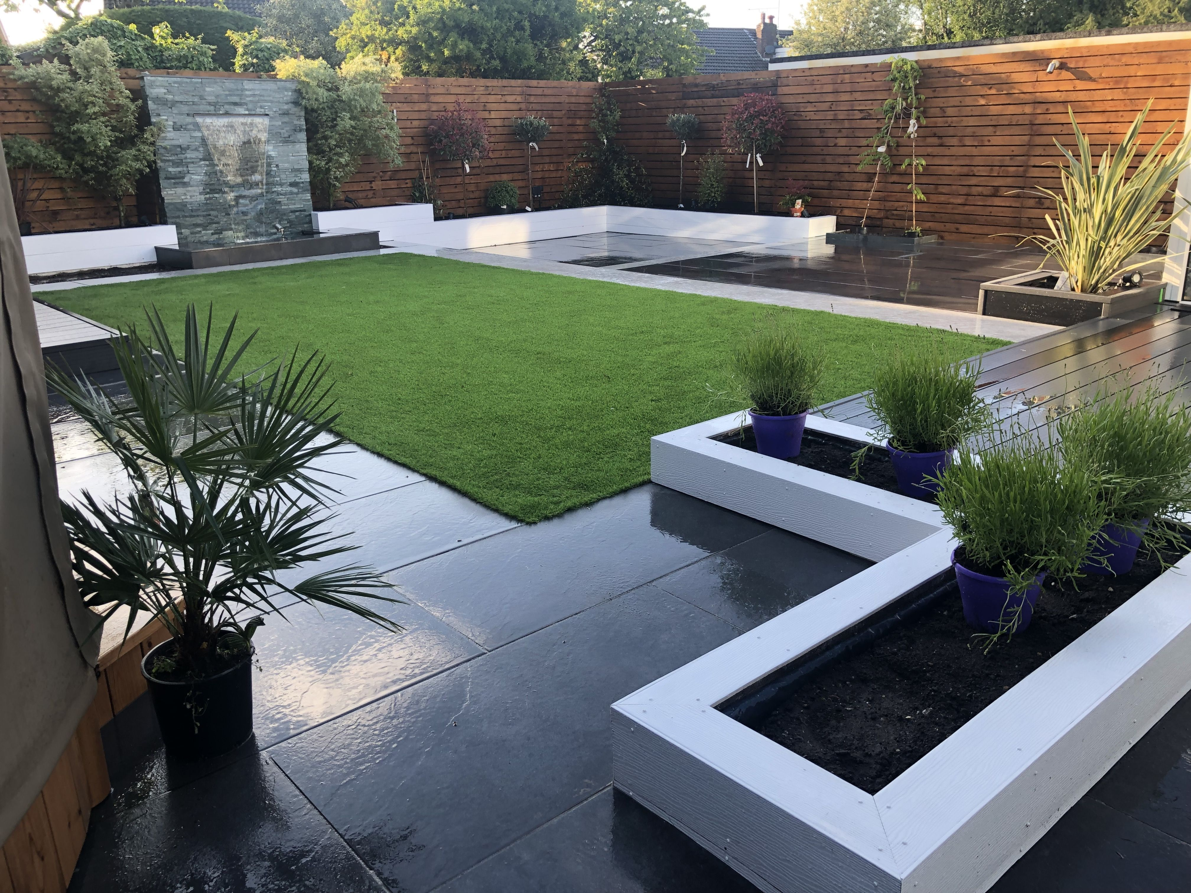 Low Maintenance Garden With Symphony Vitrified Patio And Path Composite Deckin Modern Backyard Landscaping Backyard Landscaping Designs Outdoor Gardens Design Modern garden ideas with sleepers