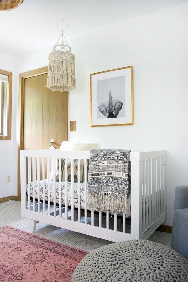 A modern boho chic nursery for a