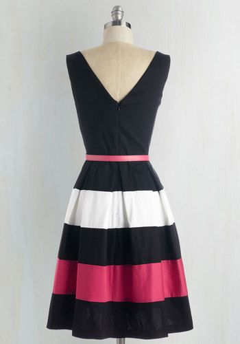 20ab01e59c1e Bear witness to the brilliance that is this black dress! Boldly designed  with white and bright pink bands on its box pleated skirt