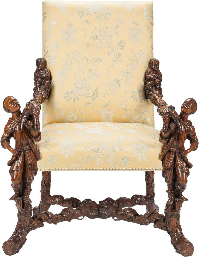 An Italian Renaissance Revival Upholstered Walnut Figural Armchair