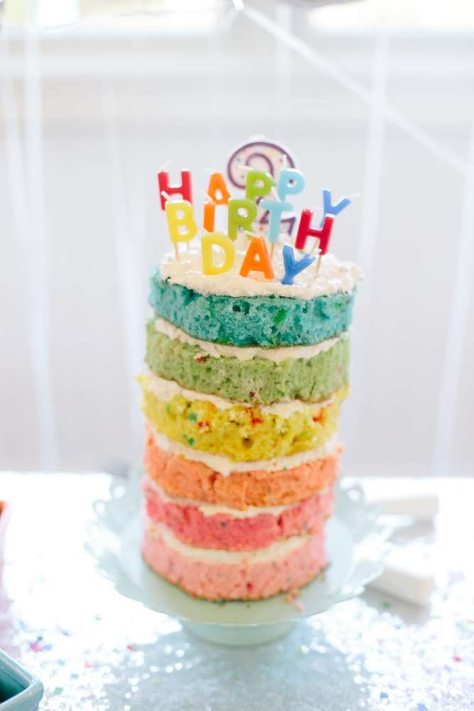 Layer cake at a rainbow, confetti and balloons birthday party! See more party ideas at CatchMyParty.com!
