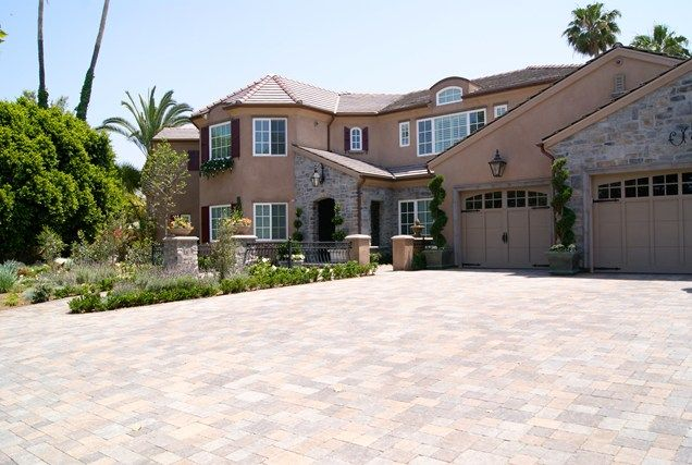 Driveway pavers, you can have them in any color to match the house! (brick, pavers, cobblestones)