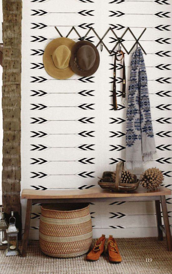 Arrow wallpaper, exposed beams, old bench and hat hooks! the perfect hallway!