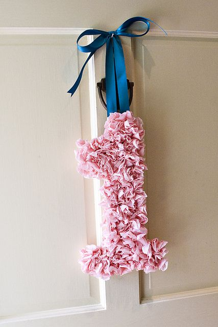 """birthday """"wreath"""" made out of streamers"""