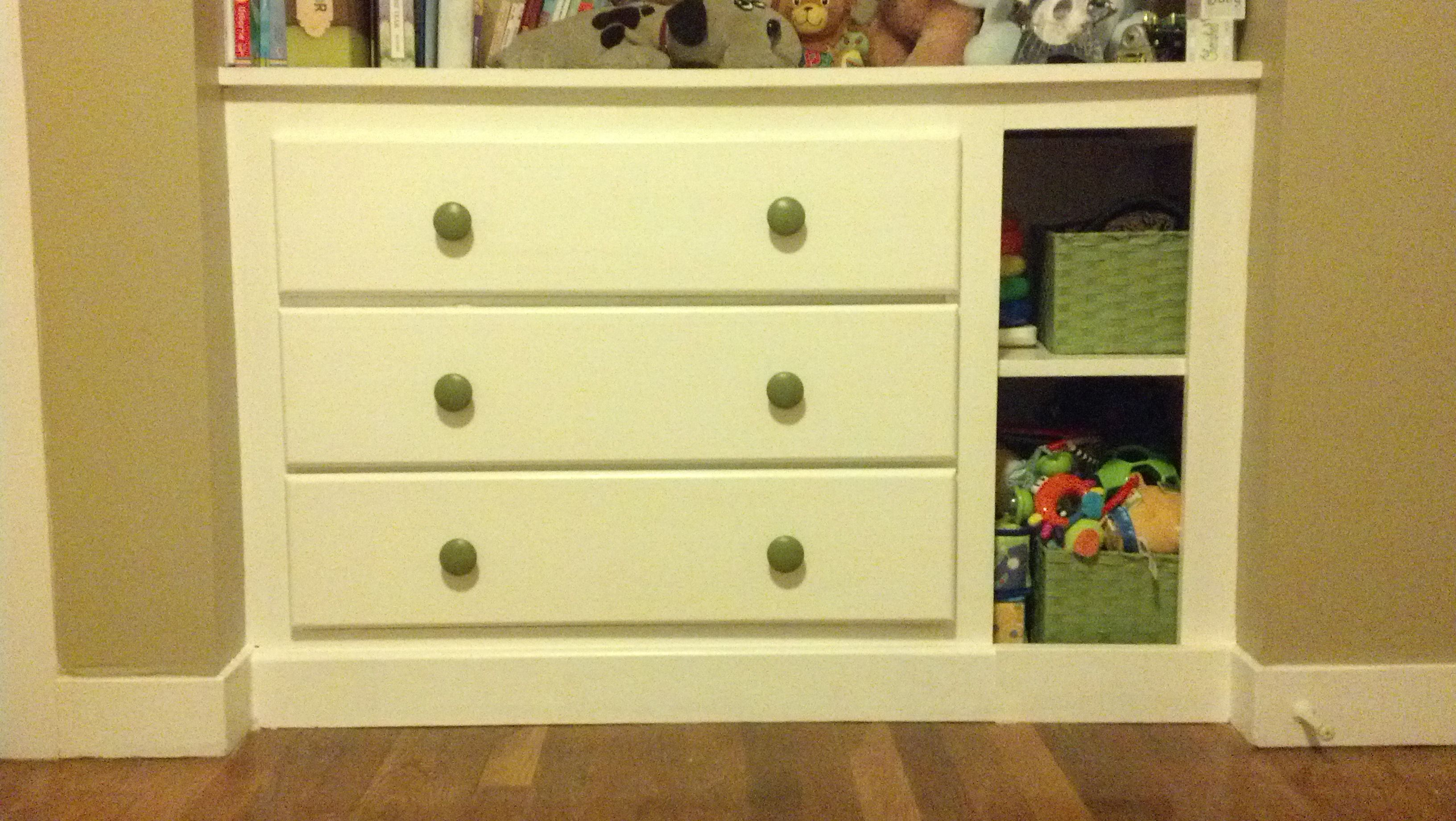 Diy built in dresser with side shelves and knobs painted to match the pin stripe on the wall