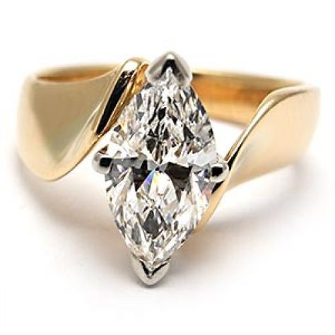 gold ring with big solitaire marque diamond