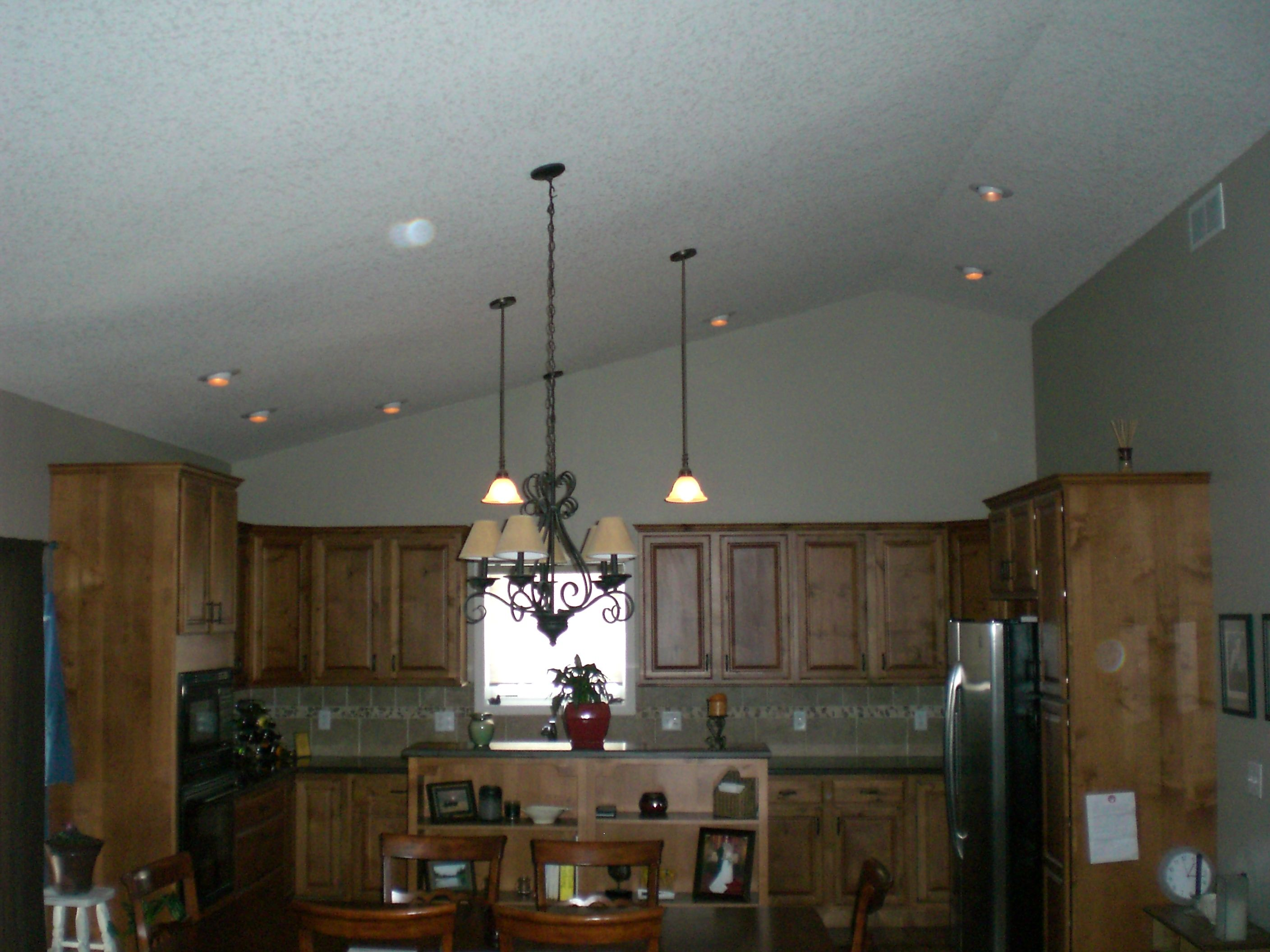 Looking for lighting for the kitchen. I like the idea of pot lights ...