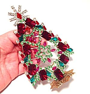 Vintage Red Green Pink Rhinestone Christmas Tree Village Decoration (Image1) Sparkling Czech Glass rhinestone Chrsitmas tree featuring center dangle clusters that are movable. The rhinestones are ruby red, emerald green, peridot green, dark rose pink, light pink and clear. All stones are prong set. Approx. 5.9 inch tall, attached to a gold tone metal stand base.