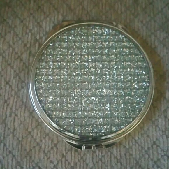 Sparkle Compact Mirror NWT Comes with dustbag and box.   Sparkles on front.   Clasp opens to two mirrors.  Perfect gift for you and anyone else.   Because every girl needs a little sparkle in her life.   Gorgeous. Accessories