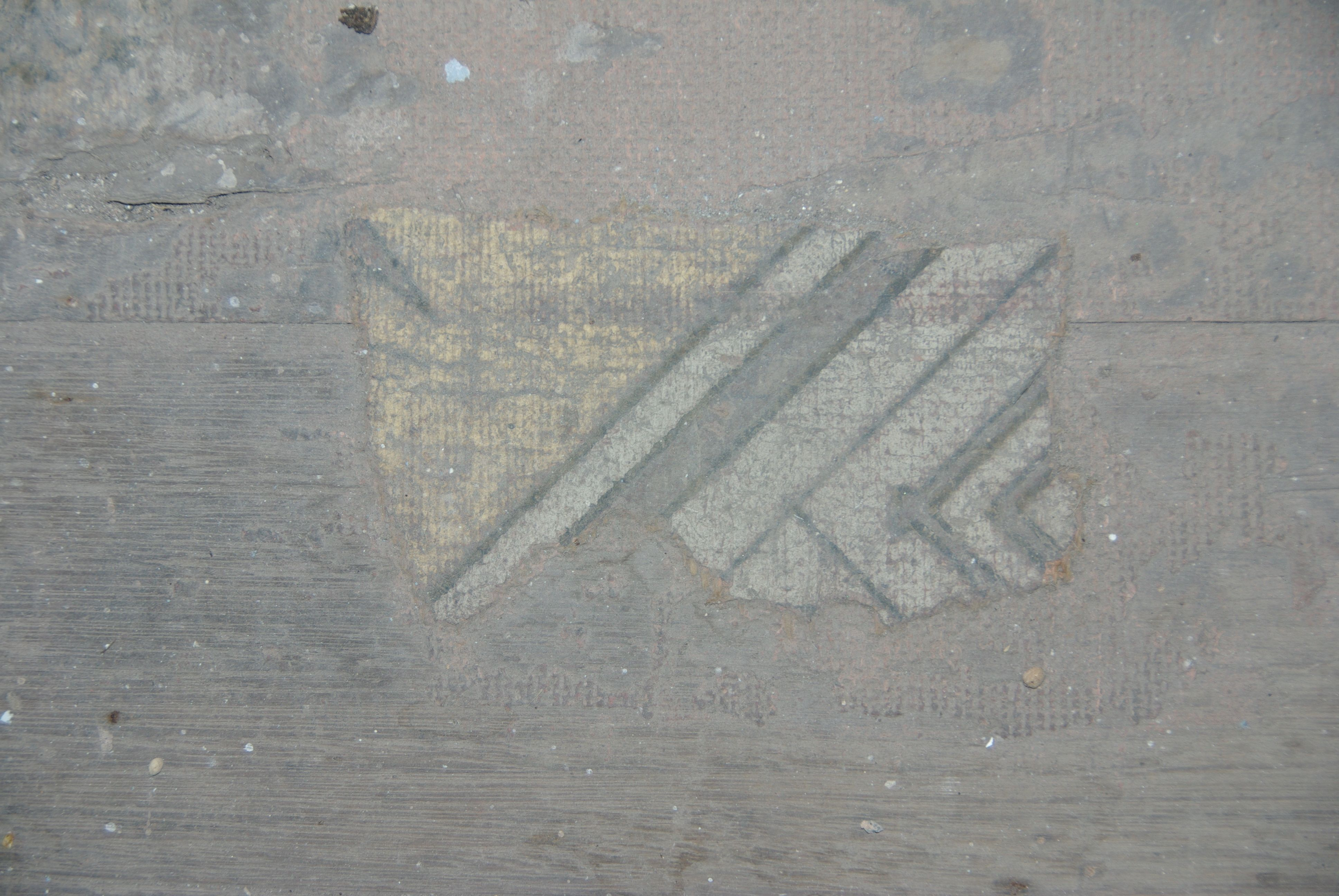 Tiny surviving linoleum fragment with a hessian backing, still adhered to timber floor. Mills Cottage, Port Fairy
