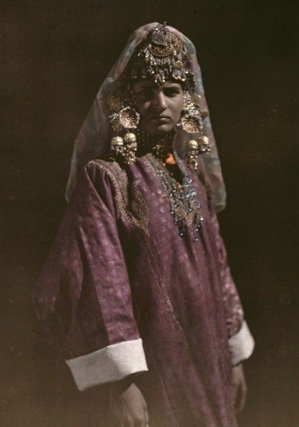 India | A young Kashmiri girl poses in her traditional attire. Kashmir, 1929 | ©Franklin Price Knott