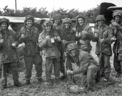 This picture was taken on 10th June, four days after the landings. It shows a group of paratroopers from 12th Parachute Battalion who were dropped in enemy territory far from DZ 'N' and spent the next four days trying to link up with their battalion. Here they enjoy a deserved cup of tea.
