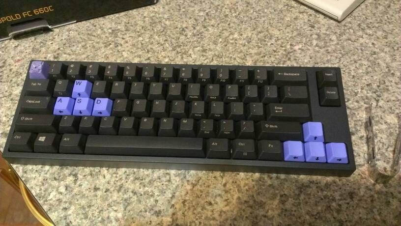 Leopold FC660C stock caps with some lavender. Shows nicely how the lasered caps fit with colorful ones with black legend.