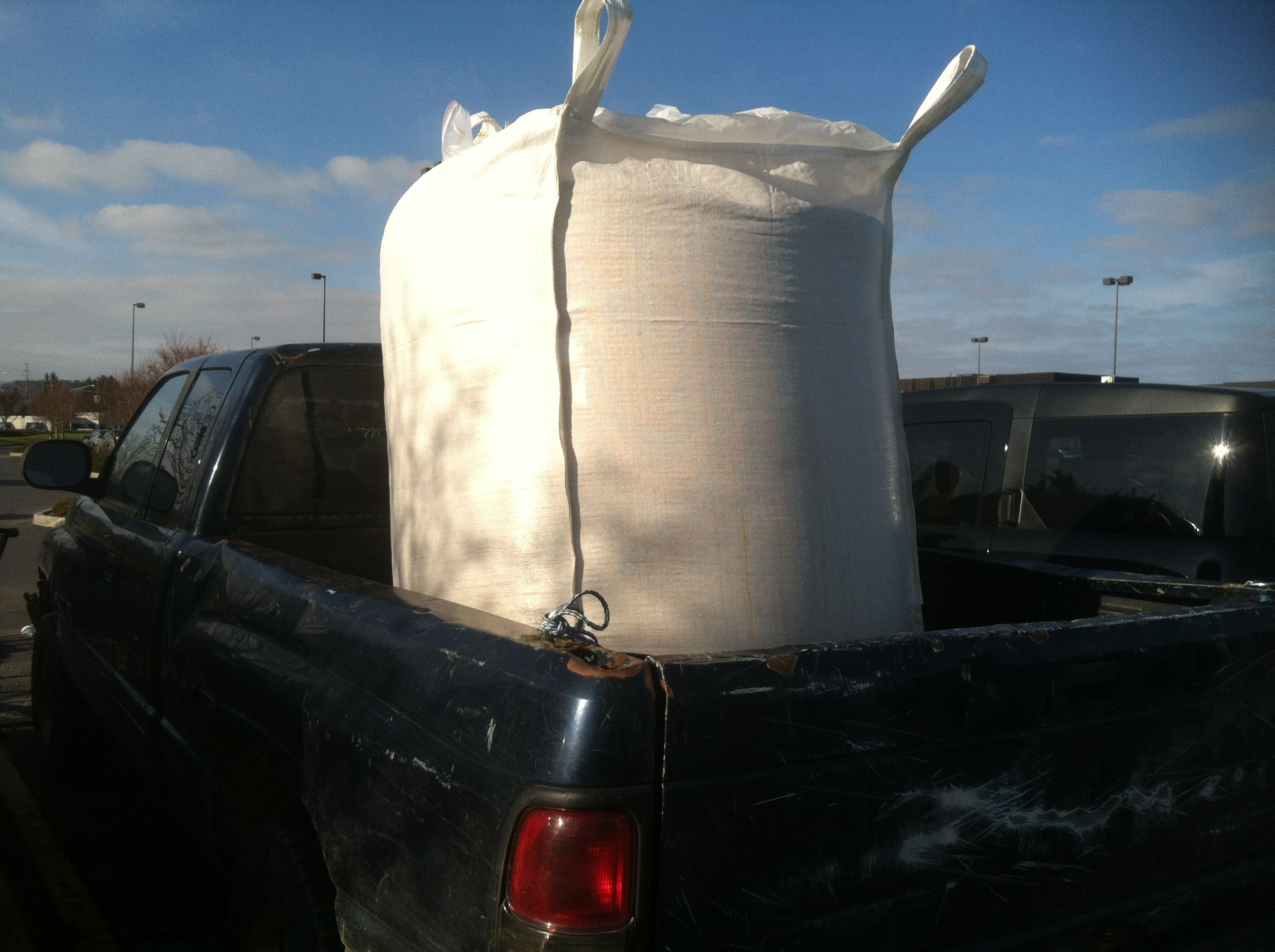 A t-ton tote of malting barley grain arriving for malting at FarmHouse Malt in Newark Valley, NY.