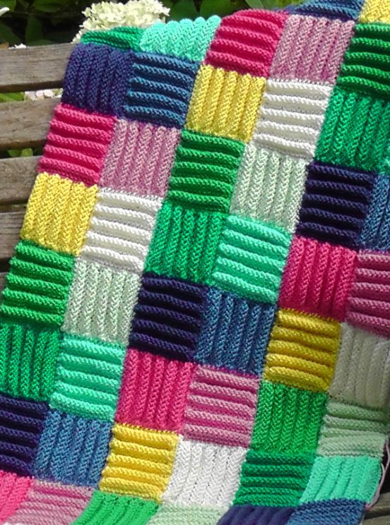 Free Knitting Pattern for Easy Corduroy Afghan - This easy throw is created from knitted squares with deep stocking stitch rolls to add coziness and texture. The designer Frankie Brown says it can also be used for a rug. Great use for scrap yarn. Pictured project by gicki .