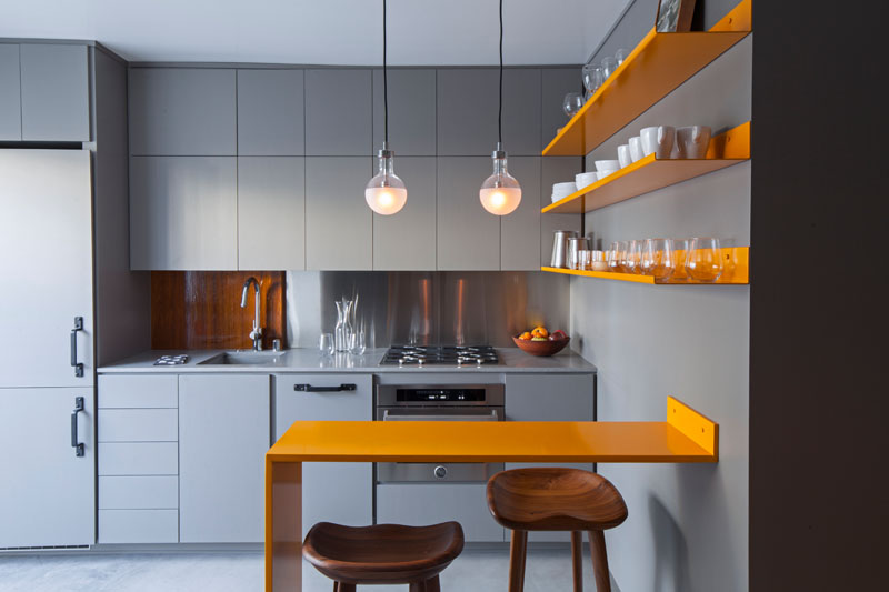 a micro apartment with a grey and yellow color palette micro apartment yellow kitchen designs on kitchen ideas yellow and grey id=16434