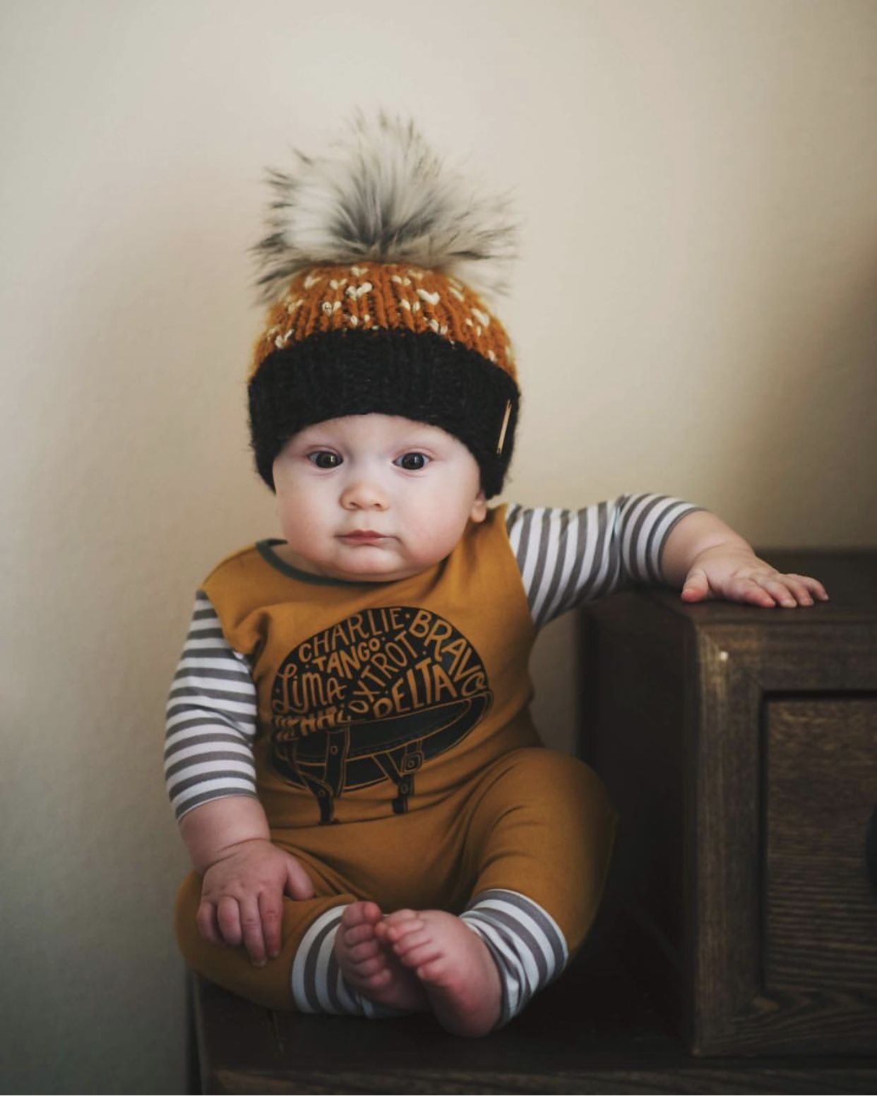 Baby boy style. Baby boy winter style fall style. Faux fur pom pom beanie  hat. Wild Rumpus Nickichicki knit hat. Romper outfit idea. 216b525dda4