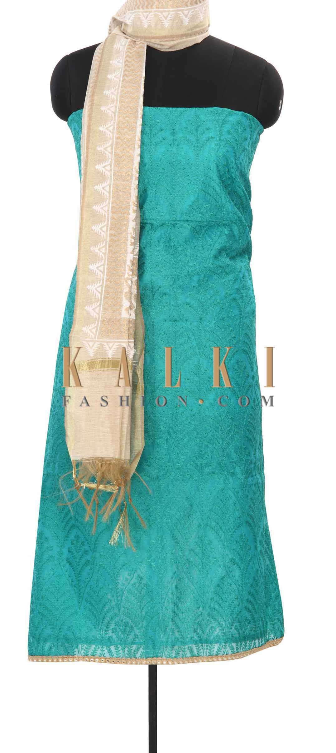 Buy this Sea green unstitched suit adorn in resham only on Kalki