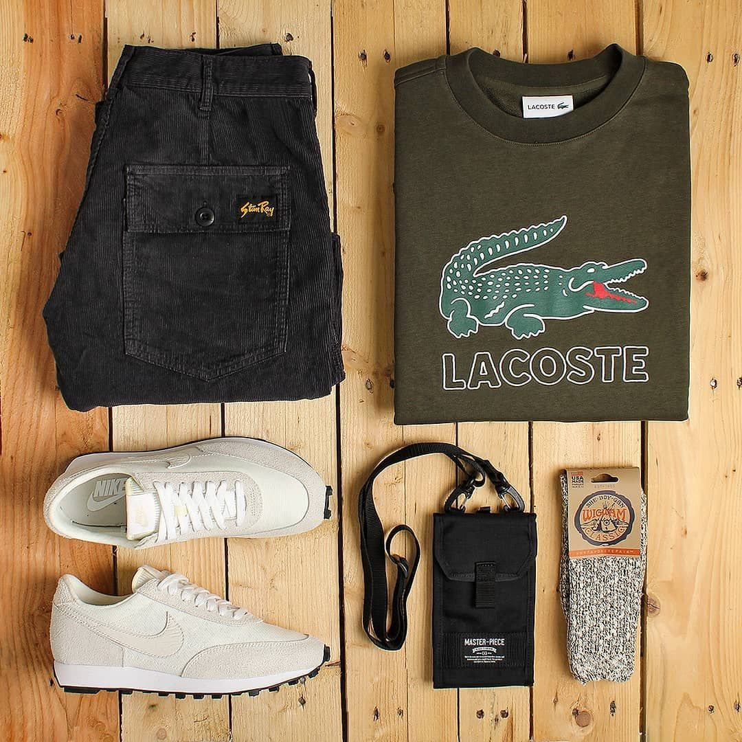 """Urban Industry's Instagram profile post: """"This outfit grid is based around the Lacoste Large Logo Crewneck Sweatshirt with it's iconic logo. Paired with that are Stan Ray Taper…"""""""
