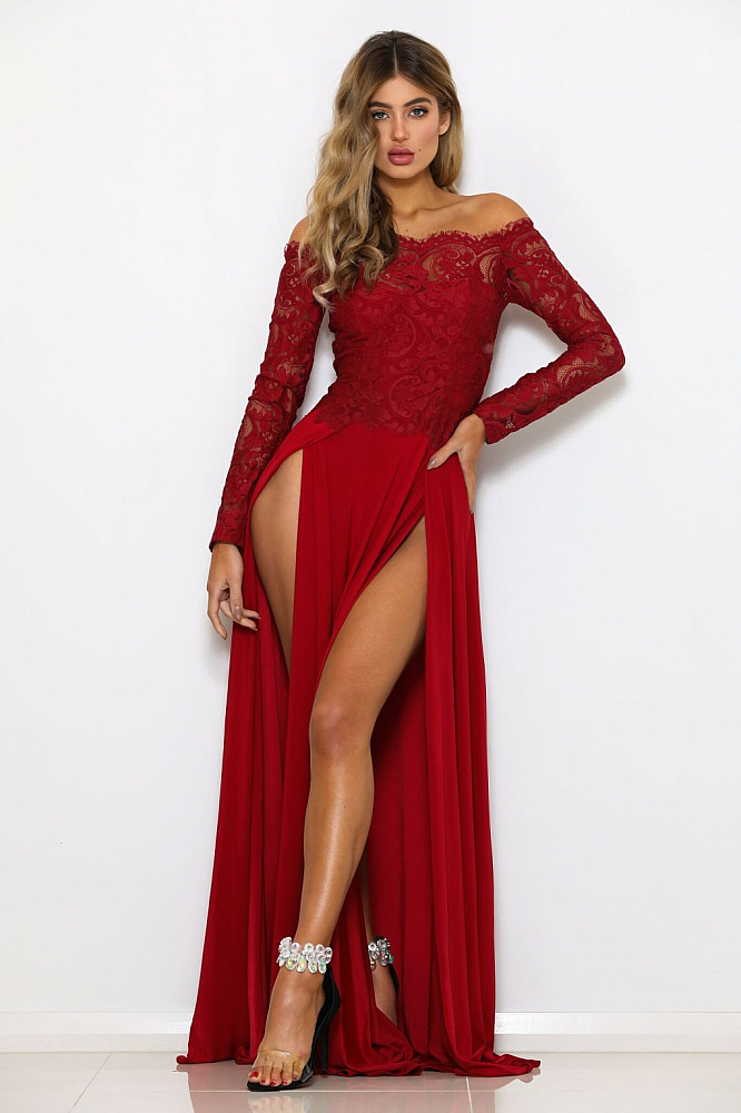 76246965b01e4 Elegant off the shoulder long sleeve lace gown with an a-line skirt and  double slits.