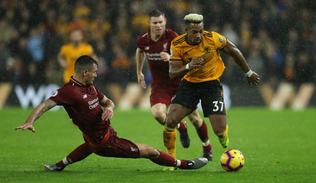 Adama Traore Of Wolverhampton Wanderers Moves Away From Dejan Lovren Wolverhampton Wanderers Wolverhampton Premier League Matches