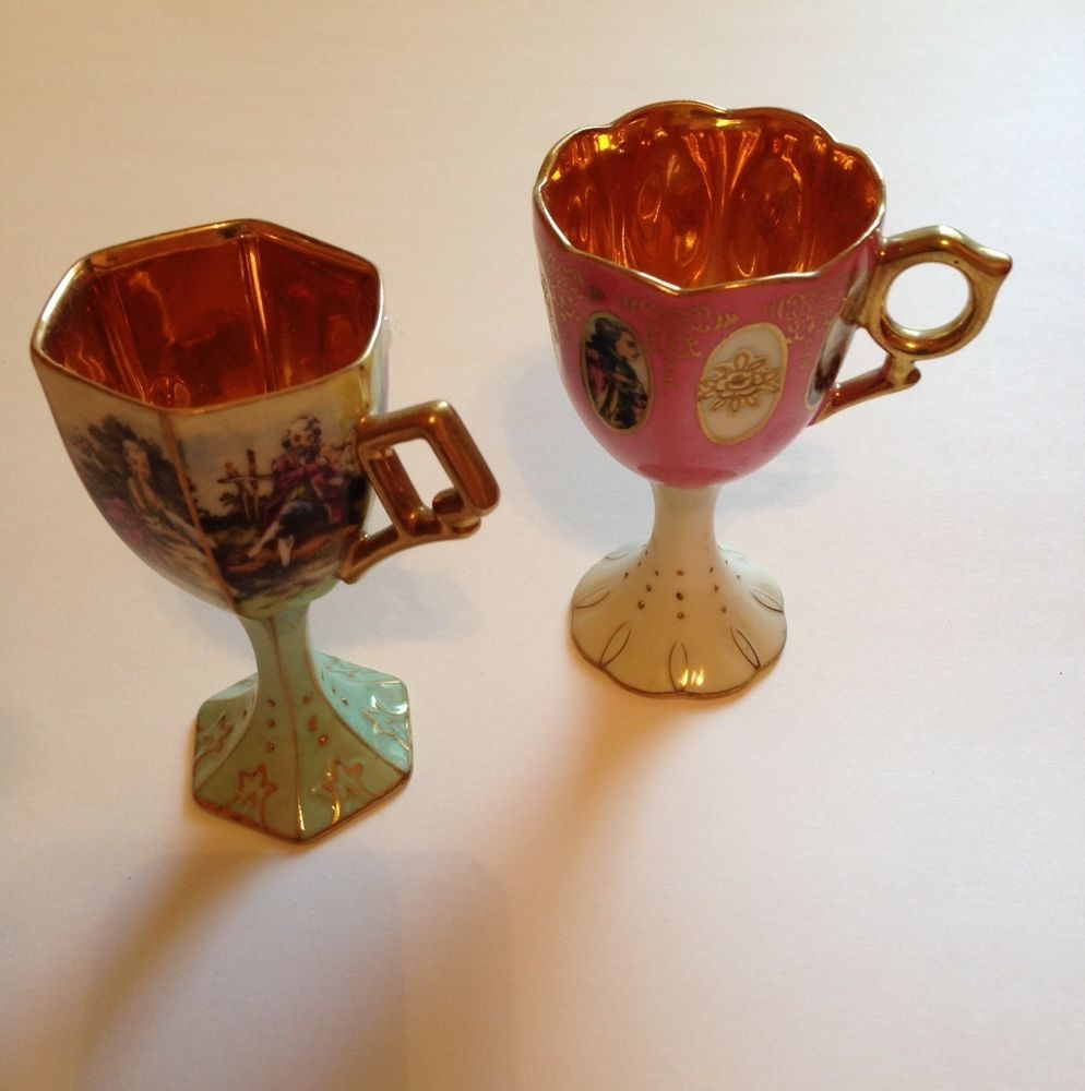 PAIR OF ANTIQUE FRENCH HAND PAINTED FOOTED DEMITASSE PORCELAIN AND GILDED CUPS