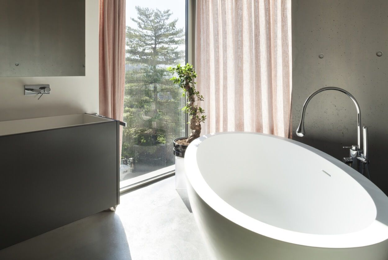 Oval Soaking Tub Next To Deep Trough Sink | Renovate Your Bathroom ...