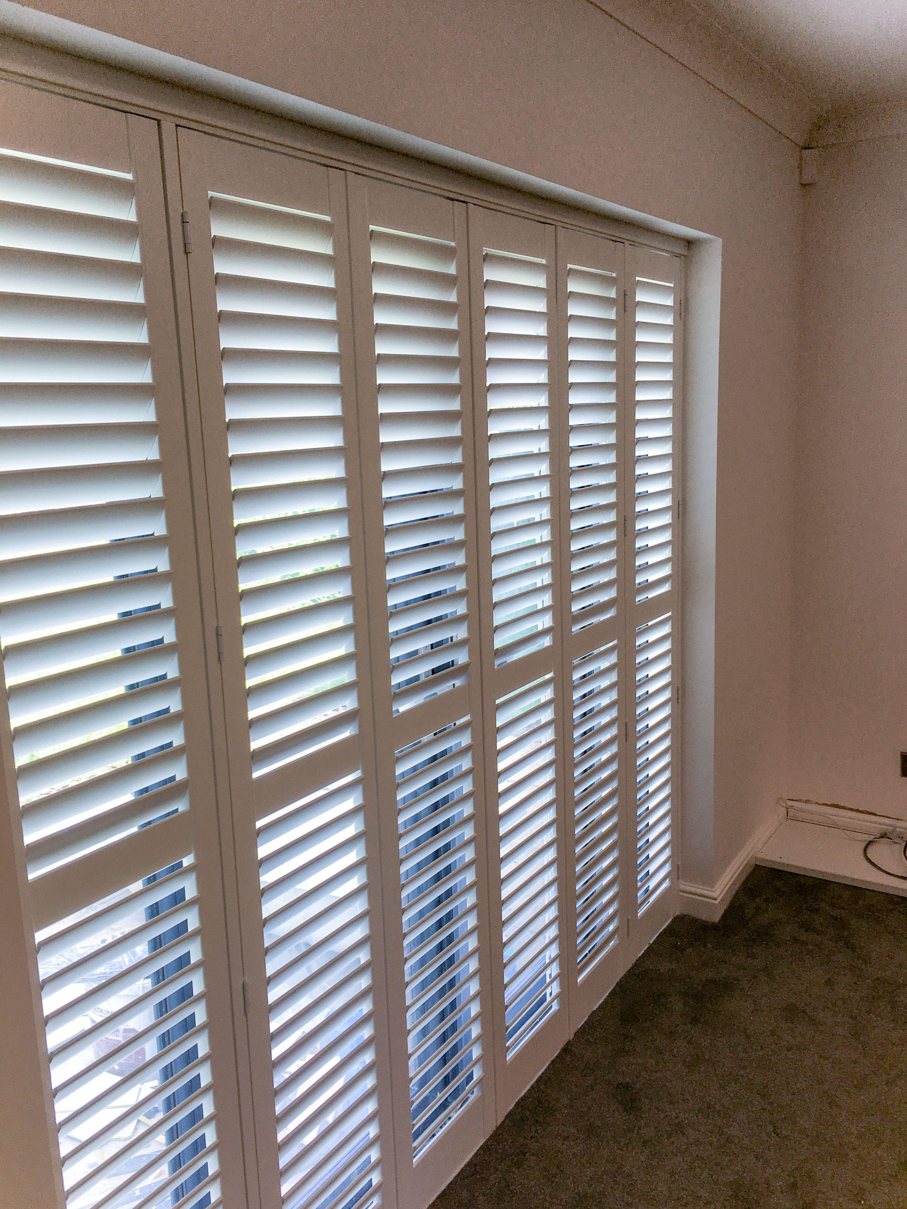 A Recent Patio Door Shutter Installation In Sale Bi Folding Hardwood