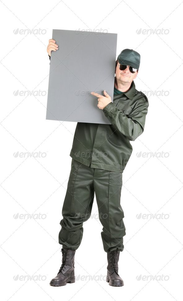 Man in workwear stands with board. ...  adult, background, black, board, body, boot, building, cap, career, chair, competence, construction, elegant, employee, full, glasses, green, hand, holding, isolated, job, labor, locksmith, look, mechanic, men, occupation, one, paper, people, person, personal, place, plumber, portrait, professional, service, shoes, sitting, suit, text, thumb, tool, uniform, up, wear, white, work, worker