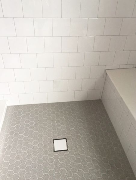 6x6 offset white wall tile with gray hexagon mosaic floor for 6x6 room design