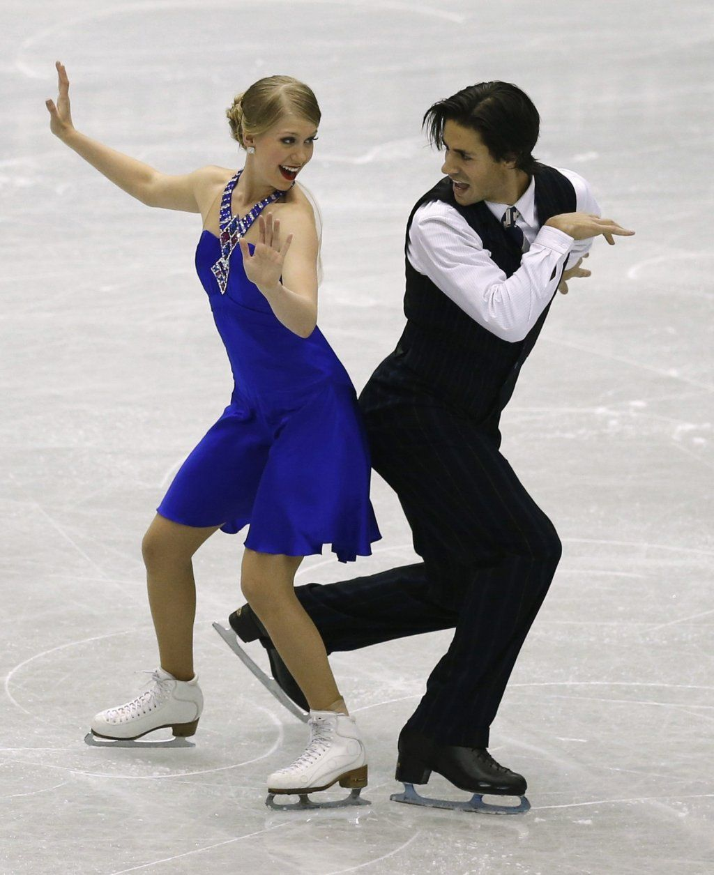 Weaver and Poje of Canada perform during the ice dance short dance at the ISU Grand Prix of Figure Skating Final in Fukuoka